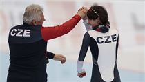 Martina Sablikova, of Czech Republic, celebrates with her coach Petr Novak after winning the women's 5000 meter race of the speedskating single distan ...