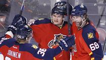 Florida Panthers left wing Jussi Jokinen (36) and right wing Jaromir Jagr (68) celebrate with center Aleksander Barkov.