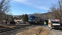 First responders work at the scene where train carrying Republican members of Congress collided with garbage truck in Crozet, Virginia