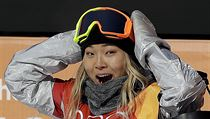 Chloe Kim, of the United States, reacts to her score during the women's...
