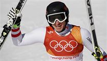 Austria's Matthias Mayer celebrates after finishing the men's super-G at the...