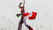 Bronze medal winnow Katharina Gallhuber, of Austria, walks off the podium after the venue ceremony at the women's slalom at the 2018 Winter Olympics i ...