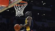 "Indiana Pacers' Victor Oladipo dunks while wearing a mask from the movie ""Black Panther"" during the NBA All-Star basketball Slam Dunk contest, Saturda ..."