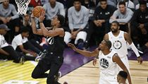 Team Stephen's DeMar Derozan, left, of the Toronto Raptors, shoots as Team LeBron's Kevin Durant, second from left, of the Golden State Warriors, Kyri ...