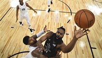 Team Stephen's James Harden, right, of the Houston Rockets, shoots as Team LeBron's Paul George, of the Oklahoma City Thunder, defends during the seco ...