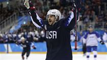 Garrett Roe (11), of the United States, celebrates after scoring a goal against Slovakia during the third period of the qualification round of the men ...