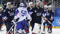 Goalies Jan Laco (50), of Slovakia, and Ryan Zapolski (30), of the United States, greet each other adfter the qualification round of the men's hockey  ...