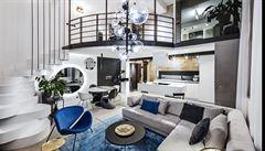 Jak bydlí designéři: byt v bývalé továrně, kamenný jídelní stůl a elektrická kytara