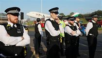 Police officers stand guard during an Extinction Rebellion protest outside...