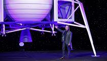 Jeff Bezos speaks in front of a model of Blue Origin's Blue Moon lunar lander,...