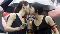 Same-sex marriage supporters kiss outside the Legislative Yuan Friday, May 17,...