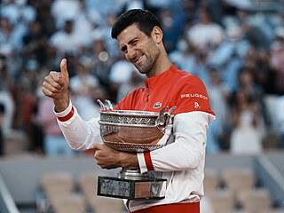 Novak Djokovič slaví svůj 19. grandslam.